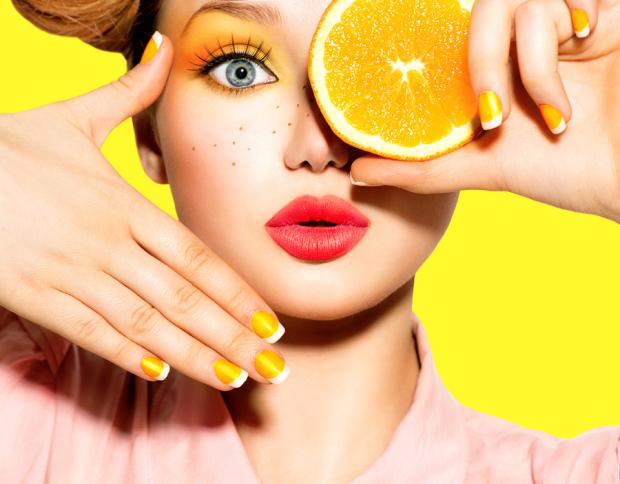 Beauty Model Girl takes Juicy Oranges. Beautiful Joyful teen gir