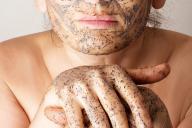 Mature woman making cosmetic mask
